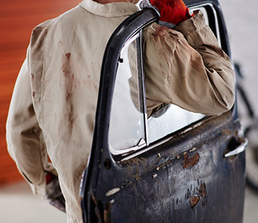 A man in rust-stained work clothes