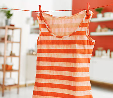 Dirty, striped top hang drying