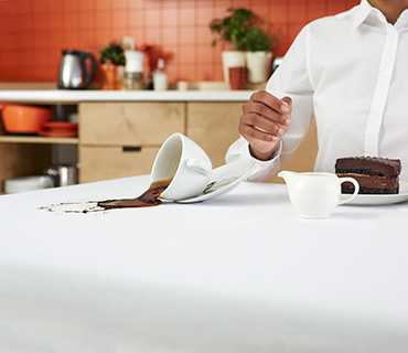 A white tablecloth stained with coffee