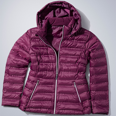 A burgundy down jacket on a white table