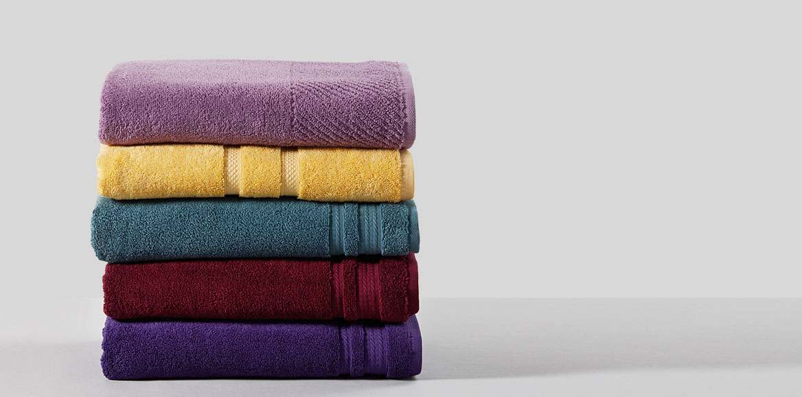 A pile of folded colorful towels