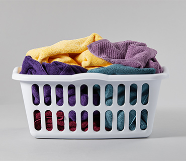 Colorful towels in a laundry basket