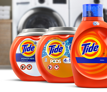 Tide Liquid and PODS products in front of a washer