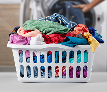 Coloured Clothes in a white basket