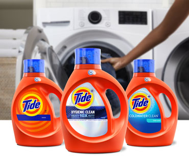 Tide liquid detergent products in front of a washer
