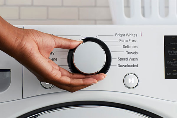 Select the wash cycle and water temperature on your washing machine