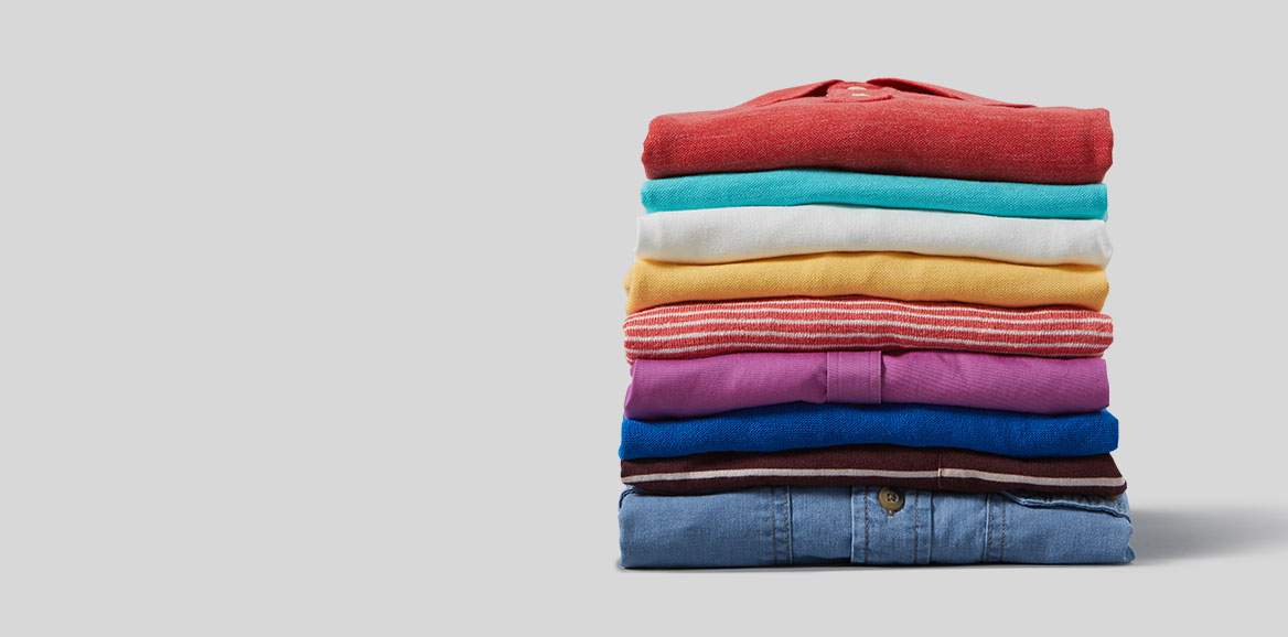 A pile of neatly folded, colorful clothes