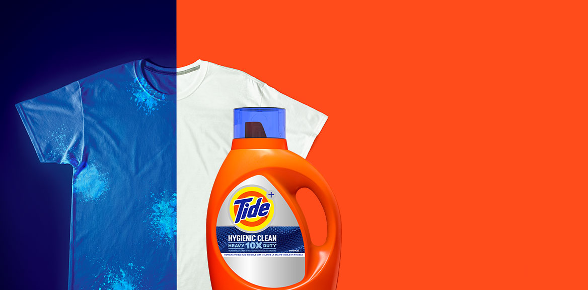 A stained white t-shirt under UV light and a bottle of Tide Hygienic Clean Heavy Duty 10x Liquid Detergent