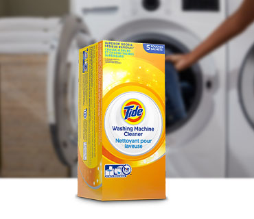 Tide Washing Machine Cleaner in front of a washing machine