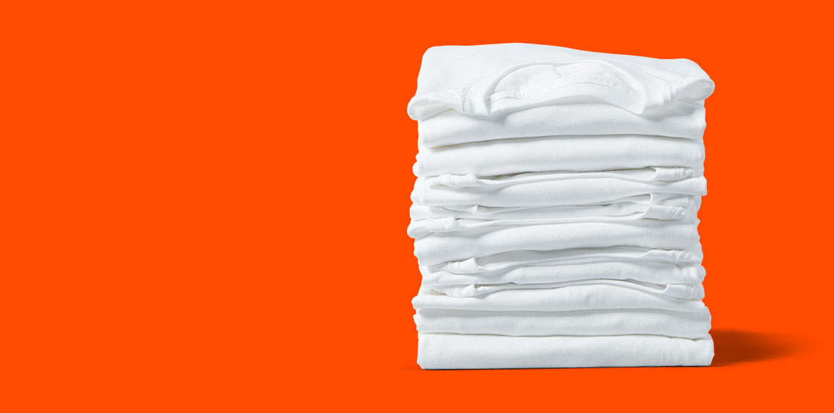 A pile of folded white clothes