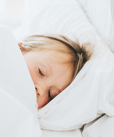 Child sleeping in bed.