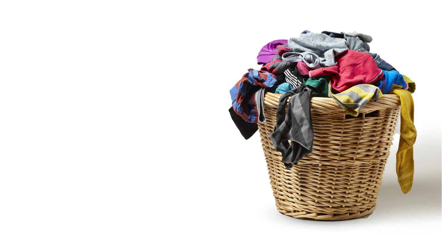 A basket full of dirty clothes waiting to be washed with Tide Plus Febreze Laundry Detergent