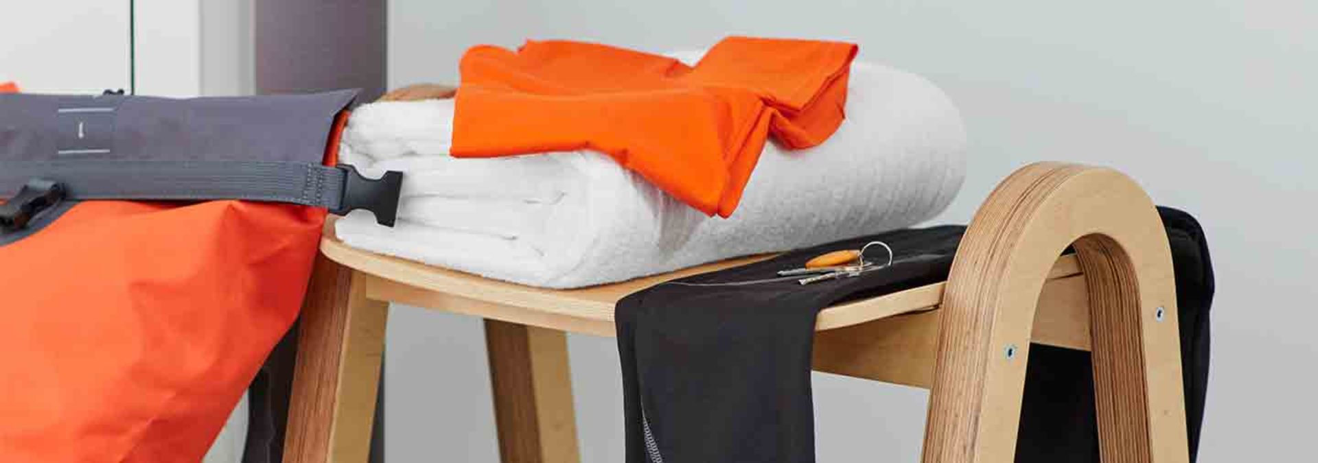 Workout clothes and a white towel on a table