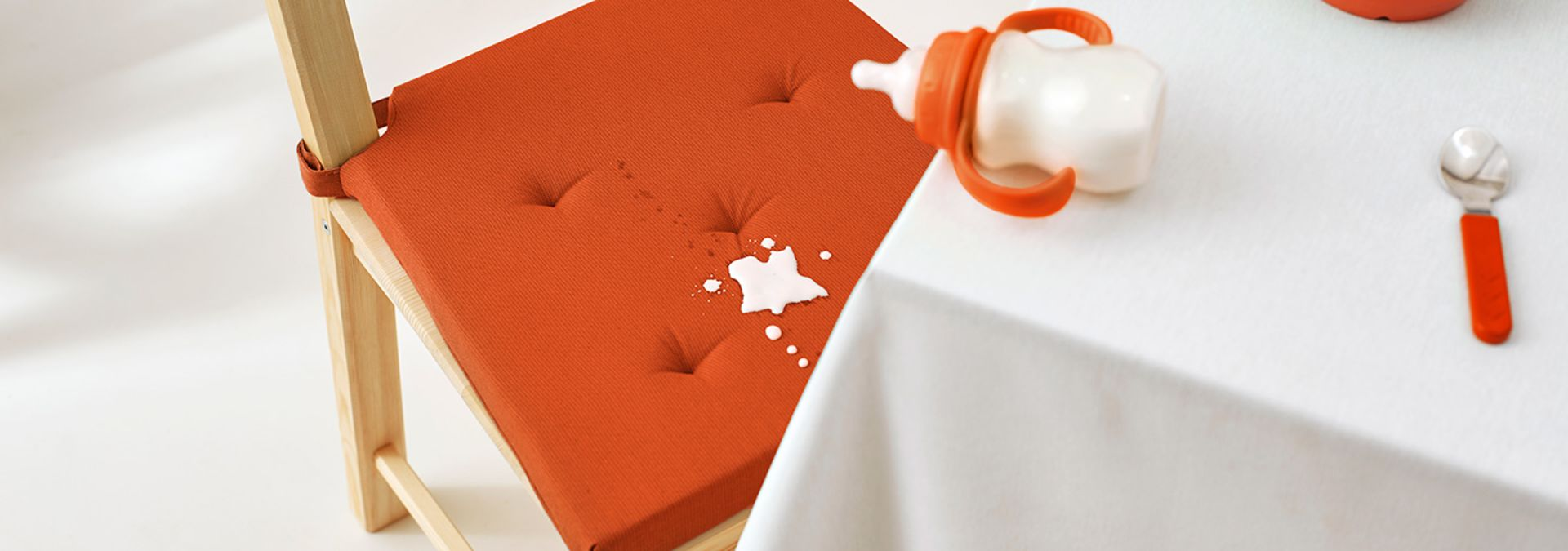 Baby formula stains on an orange chair cover
