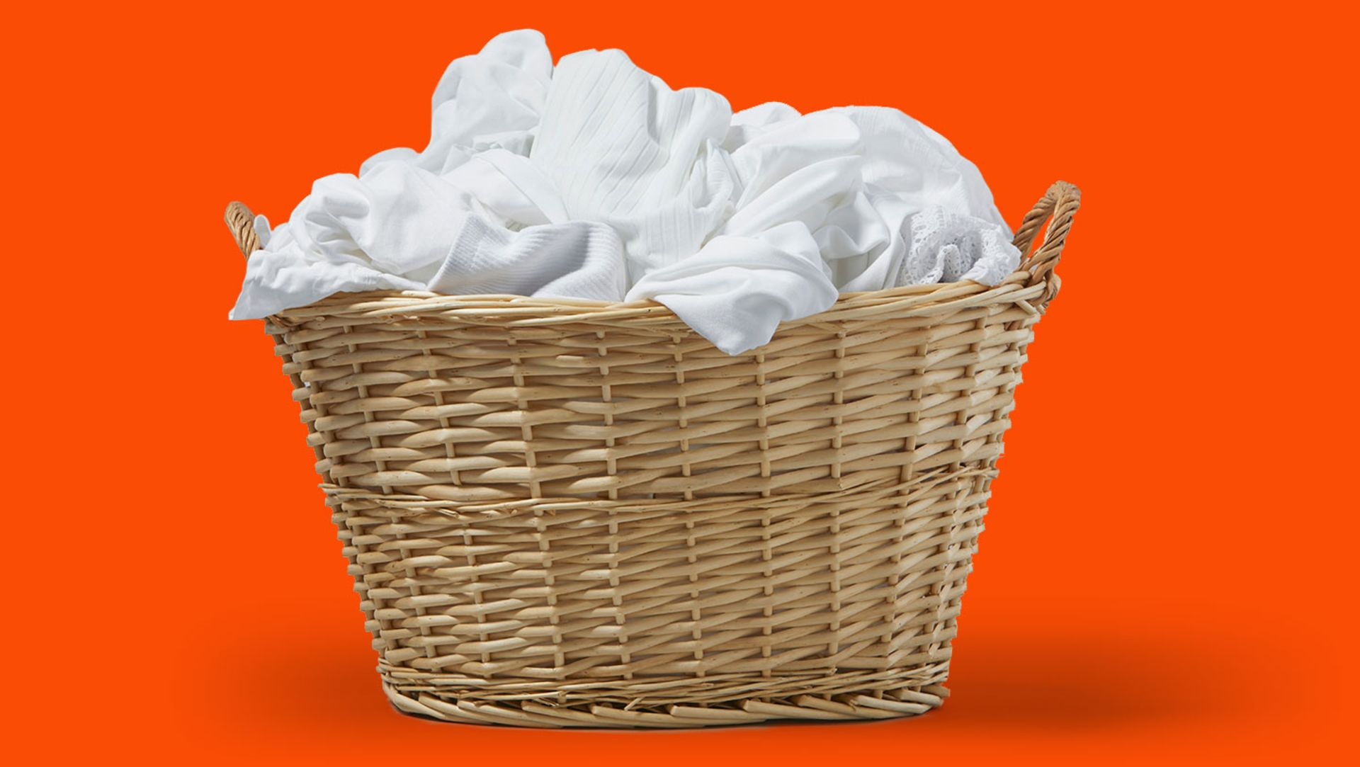 White garments in a woven laundry basket
