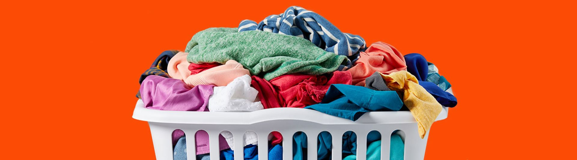 A laundry basket full of colorful garments