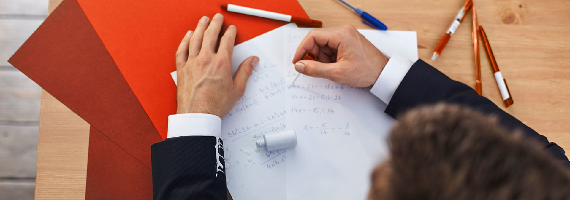 A man is correcting document with correction fluid