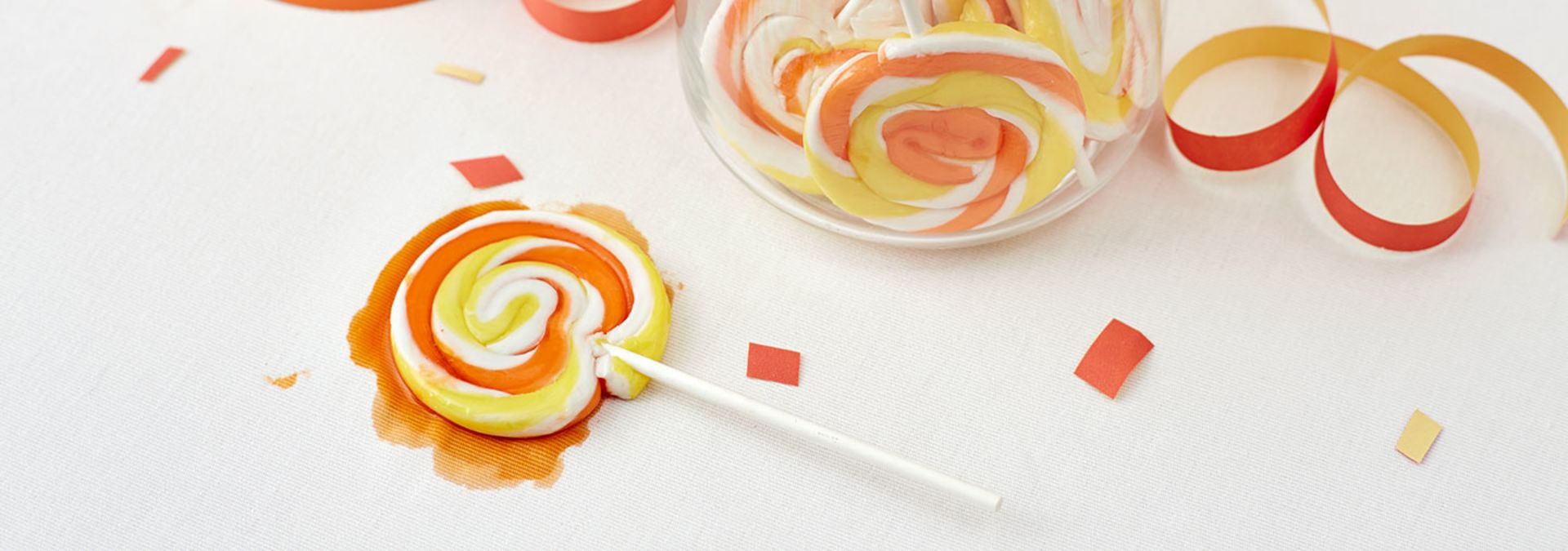 Melted swirl lollipop on white tablecloth