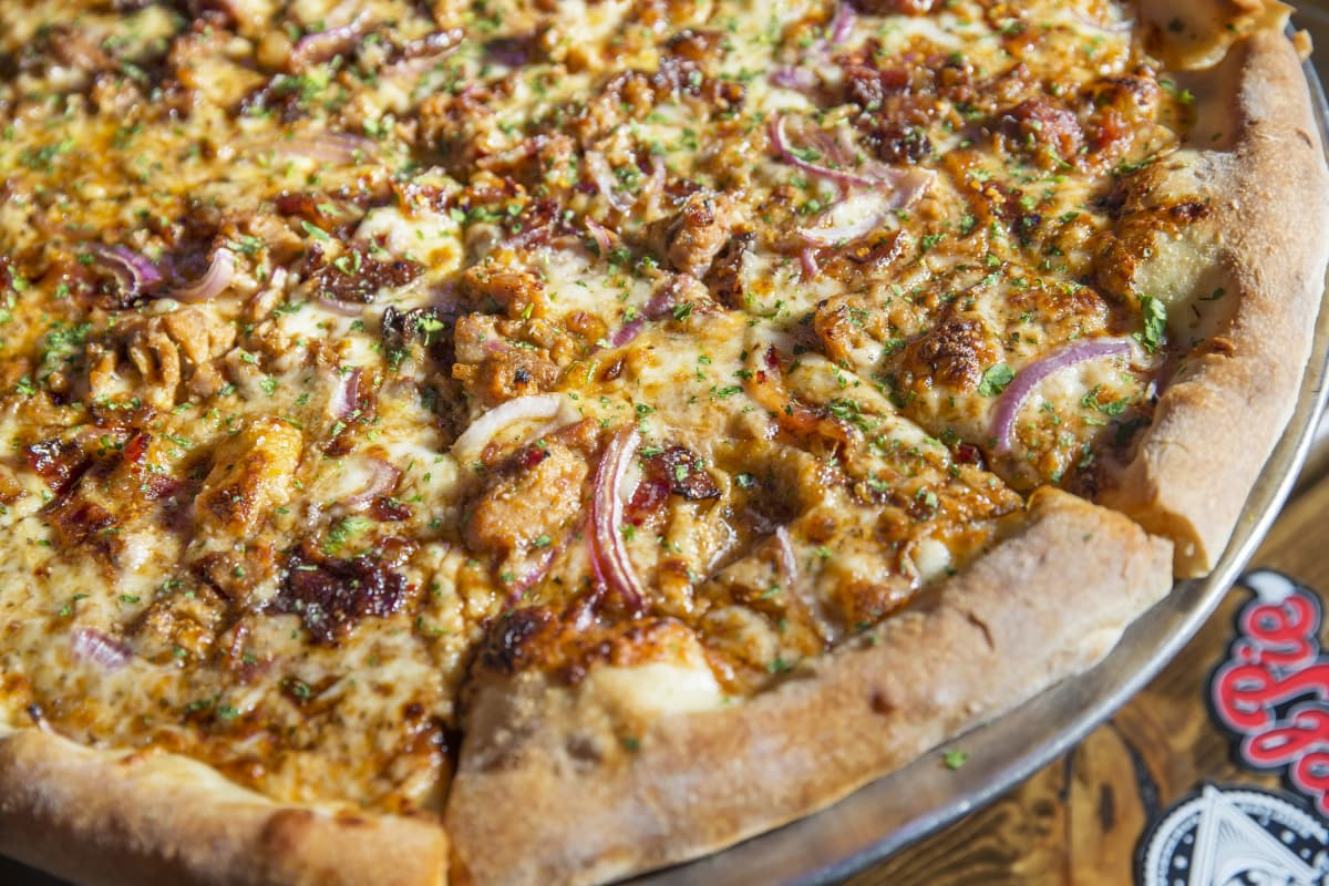 The Hog Heaven pizza at Evel Pie is made with man candy bacon, pulled pork, red onions, parsley, smoked mozzarella and barbecue sauce. (Benjamin Hager/Las Vegas Review-Journal)