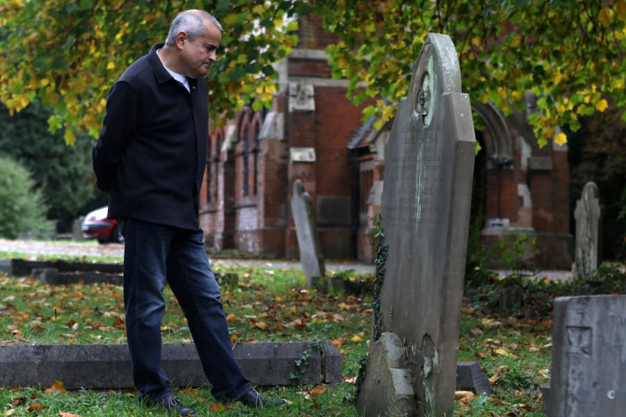 Richard Bowdery, historian for the Cray Wanderers football club, looks at a grave marker at the St. Mary Cray cemetery in London, England, on Friday, Oct. 12. Heidi Fang Las Vegas Review-Journal @HeidiFang