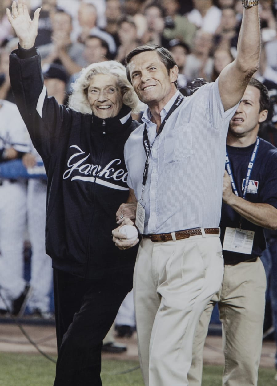 Julia Ruth Stevens and son Tom Stevens waving to fans before Ruth