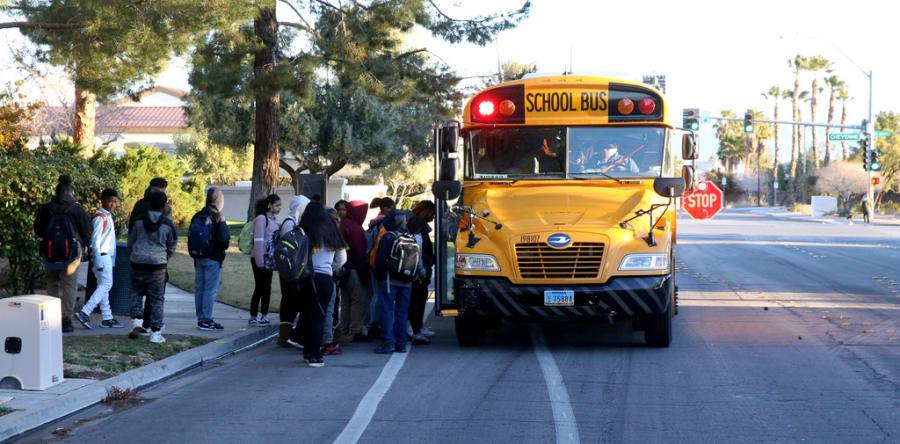 Students board the school bus on Soaring Gulls Drive near Cheyenne Avenue at Desert Shores Villas in Las Vegas Wednesday, March 13, 2019. (K.M. Cannon/Las Vegas Review-Journal) @KMCannonPhoto