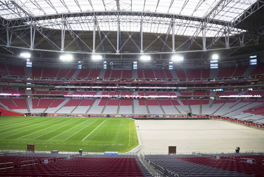 The grass field tray system is prepared for installation for the Phoenix Cardinals NFL football game Dec. 21, 2018, at State Farm Stadium in Glendale, Ariz. (Benjamin Hager / Las Vegas Review-Journal)