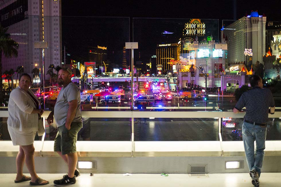 People watch from a pedestrian bridge as Las Vegas police respond during an active shooter situation on the Las Vegas Strip near Tropicana Avenue in Las Vegas on Sunday, Oct. 1, 2017. Chase Stevens Las Vegas Review-Journal