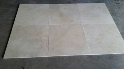 brown, gray, tan stone Crema Marfil Honed