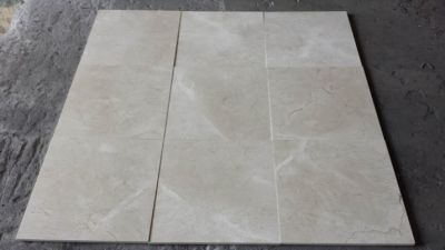 brown, gray, tan stone Crema Marfil Polished Non Beveled