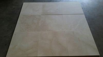 brown, gray, tan stone Crema Marfil Semi-Select Honed