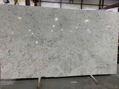 brown, tan, white granite Colonial White