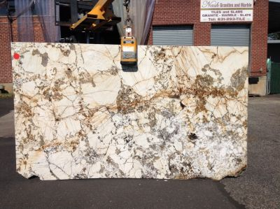brown, gold, gray, orange, white granite Granite Apoena
