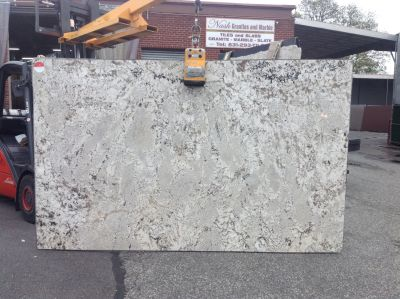 black, brown, gray, tan, white granite Granite Cachete White