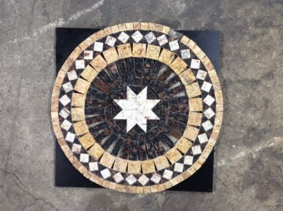 black, brown, tan, white granite Granite Medallion
