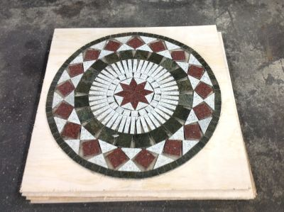 black, green, red, white granite Granite Medallion