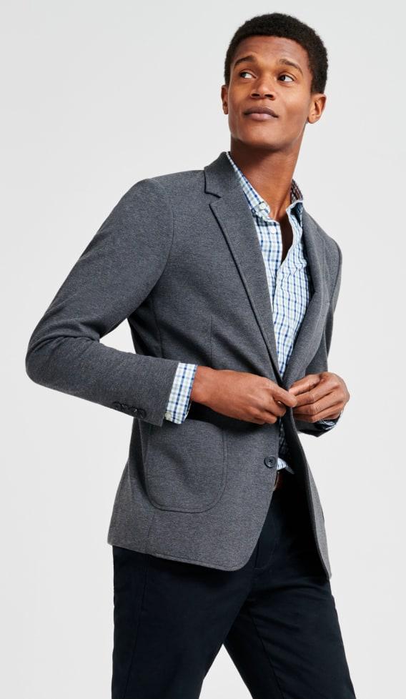 Grey blazer, check shirt and smart dark trousers