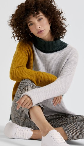Casual outfit of a colour-block jumper and trousers
