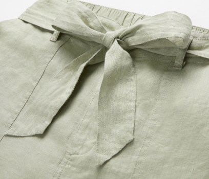 Close up of the belt on a green skirt