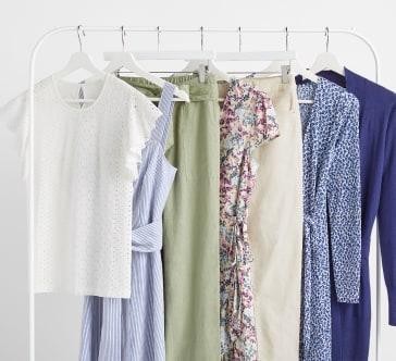 Rail full of women's tops and dresses