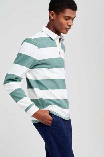 Green and white striped rugby shirt and trousers