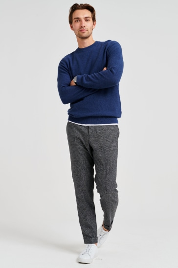 Blue jumper, grey trousers and trainers
