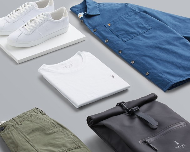 Stitch Fix X County Capsules London popular hipster men's outfit featuring a chambray shirt, a black leather backpack, a white t-shirt and white sneakers.