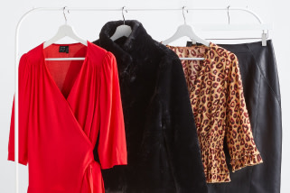 Stitch Fix X County Capsules popular Essex women's clothes rack featuring a red wrap top with long sleeves, a black faux fur coat, a leopard print shirt and a leather pencil skirt.