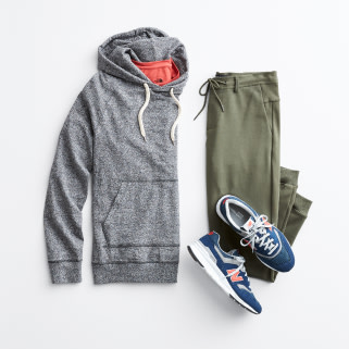 Stitch Fix men's casual clothes including a grey hoodie sweatshirt, olive pants and blue sneakers.