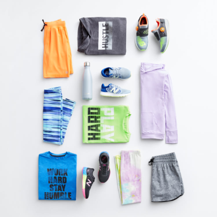 Folded Stitch Fix Kids active clothes including shorts, shirts, sneakers, leggings and hoodies.