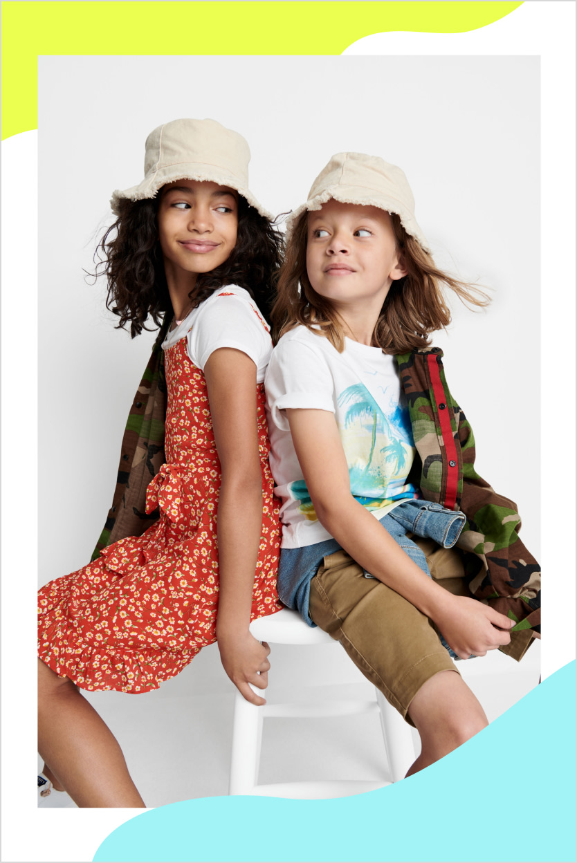 Models wearing Stitch Fix kids clothes including a red print dress and cargo shorts with a graphic tee.