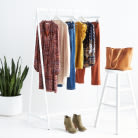 A rack with various styles of plus size athleisure and everyday clothing.