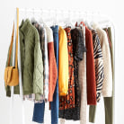 Rack of maternity clothing in various colors and styles.
