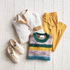 Athleisure clothing including a striped sweater, white and tan fleece jacket, yellow jogger pants and white sneakers.